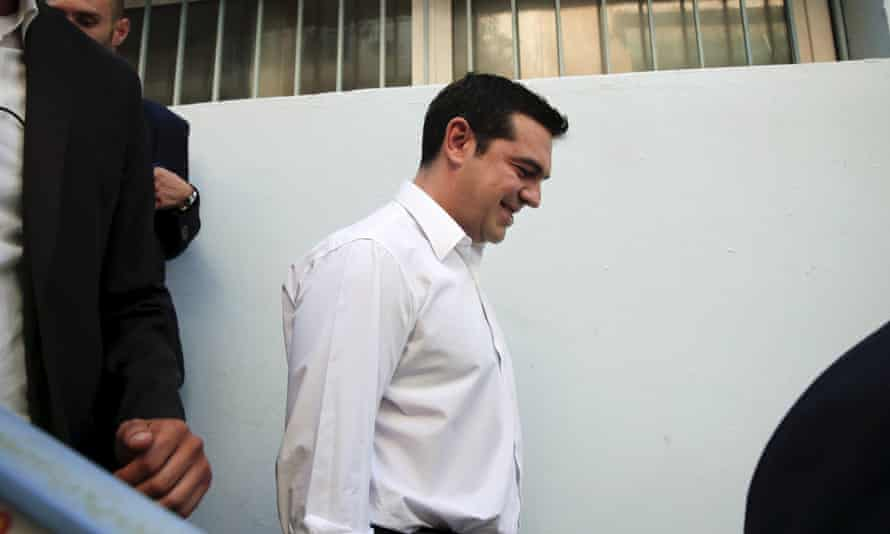 Alexis Tsipras leaves the polling station after voting in the general election in Athens.