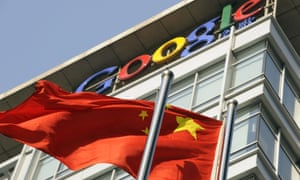 A Chinese national flag flies in front of the Google China headquarters in Beijing