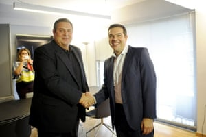Leftist Syriza party leader and winner of the Greek general elections Alexis Tsipras (R) welcomes leader of right-wing Independent Greeks party Panos Kammenos at his office at the party's headquarters in Athens, Greece, September 21, 2015. Greece's Independent Greeks party said on Sunday it would ally with election winners Syriza to form a coalition government. REUTERS/Michalis Karagiannis:rel:d:bm:GF10000214798