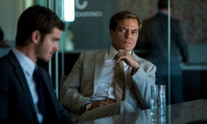 Andrew Garfield (left) as Dennis Nash and Michael Shannon as Rick Carver, in a scene from 99 Homes.