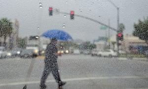 Man crossing rainy street in LA