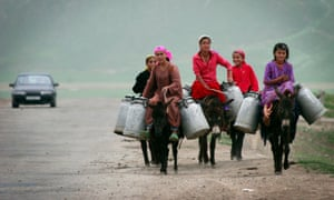 Donkeys as well as bicycles are used by women to transport goods in Tajikistan's rural areas.