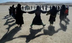 Girls play in rural Tajikistan.
