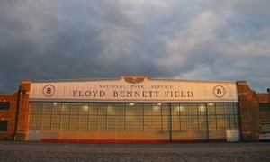 A National Park Service hangar emblazoned with the name Floyd Bennett Field glows orange at sunset at New York City's ghost airport in Brooklyn.