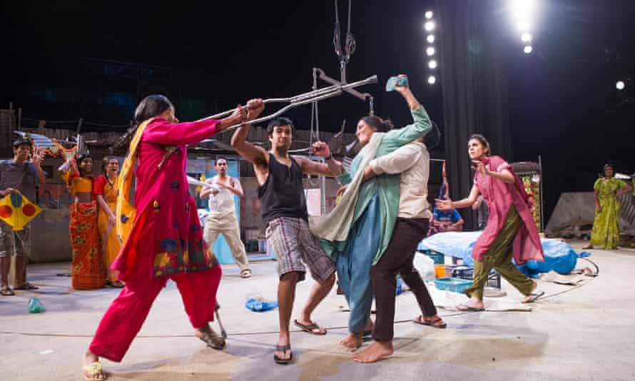 Thusitha Jayasundera, in pink and Meera Syal, in green, in <em>Behind the Beautiful Forevers</em> at the National Theatre.