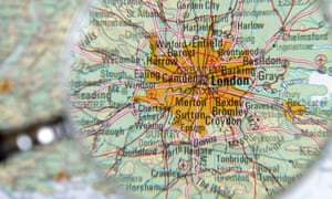Magnifying glass hovering over a map of London