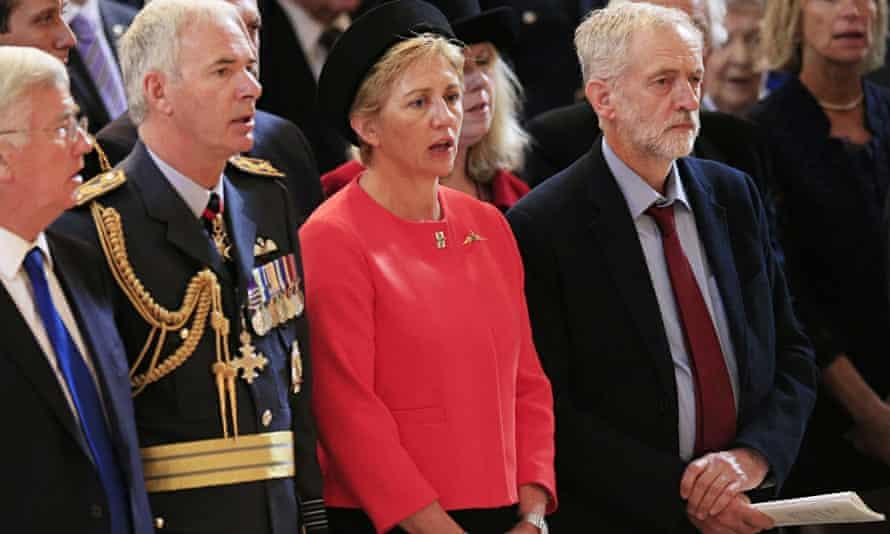 Jeremy Corbyn standing respectfully but not singing the national anthem