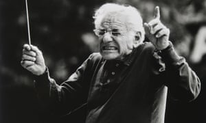 Leonard Bernstein conducting, wincing as a wrong note is played