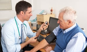 A doctor taking a man's blood pressure