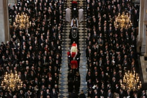The coffin of Margaret Thatcher is carried in St Paul's Cathedral during her ceremonial funeral on 17 April 2013.