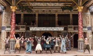 Actors perform a traditional jig at the end of a production of 'Julius Caesar' at the Globe, London.