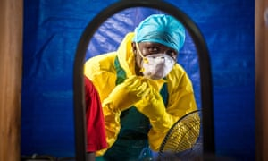 A healthcare worker dons protective gear before entering an Ebola treatment centre in Sierra Leone. The outbreak of the disease highlighted the need for better investment in science.