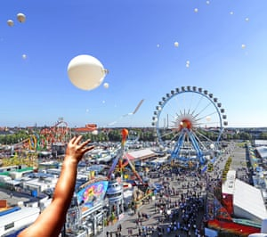 Balloons float in the air above the Theresienwiese fairgrounds of Munich during the September to October 2015 Oktoberfest.