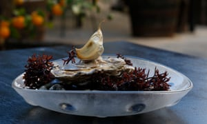 Oysters with garlic at Compartir, Cadaques