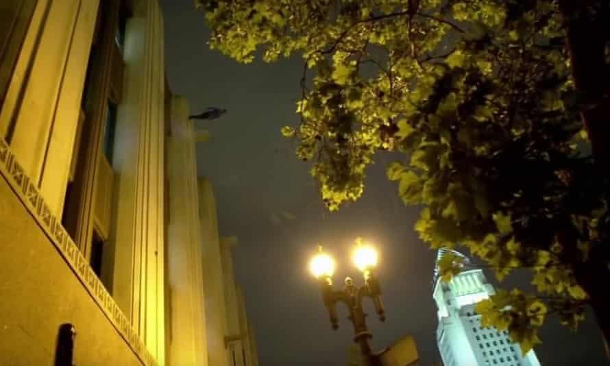Dynamo walks down the side of the LA Times building.