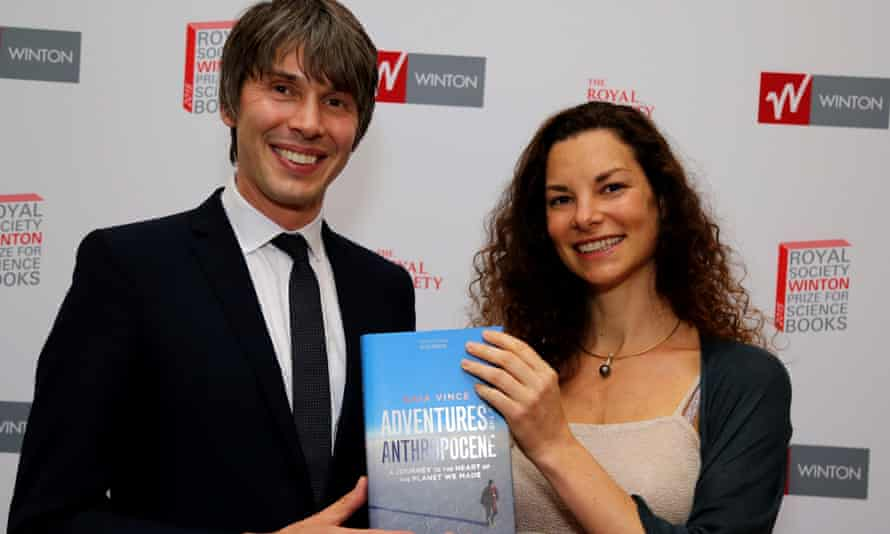 Smiles all round as Gaia Vince and Brian Cox, professor of public engagement in science, hold a copy her book Adventures in Anthropocene
