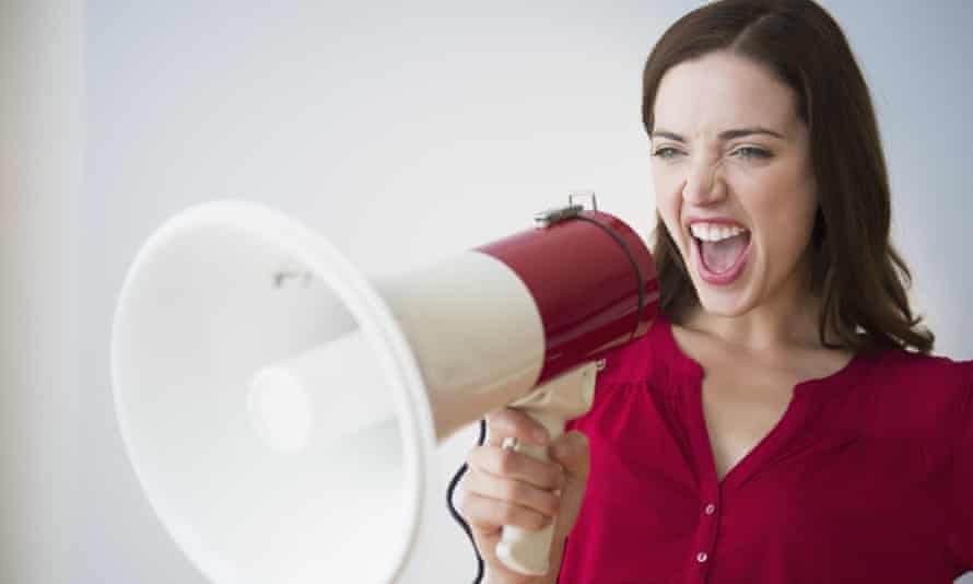 Woman yelling through megaphone