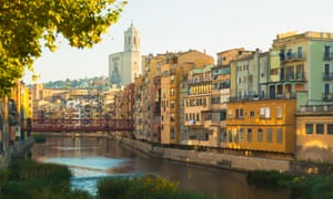 Girona cathedral and the Eiffel Bridge over the Onyar river.