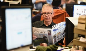 Sunday Herald editor Richard Walker (pictured with a copy pro-SNP The National) has taken redundancy from Newsquest as Gannett pecks away at costs.