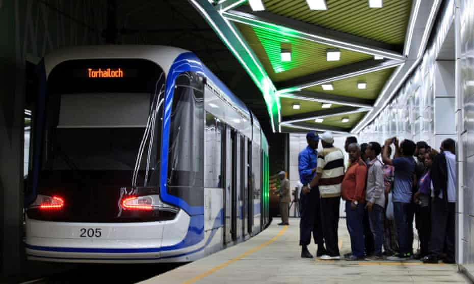 Passengers wait to board a train at the St. George underground station in Addis Ababa on 21 September 2015, a day after its opening.