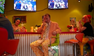 Stanhope has a drink and watches the football with friends in the Fun House.