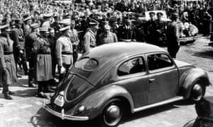 Adolf Hitler inspects the new 'people's car' in 1938.