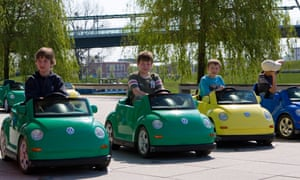 Children in battery-powered Beetles  in Wolfsburg. But what does the the future hold for them and the VW town?