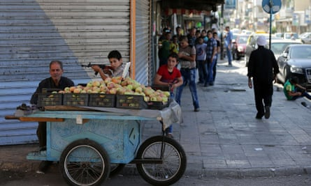 Syrian boys play with toy guns in the Syrian coastal city of Latakia, where Russian planes have been delivering men and equipment for three weeks.