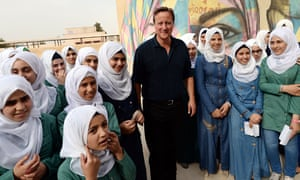 David Cameron with pupils at a girls' school in Jordan