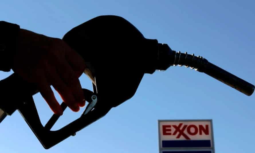 A petrol pump nozzle at an Exxon gas station.