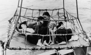 Vietnamese 'boat people' are rescued from the sea during the Vietnam War, 1960s.