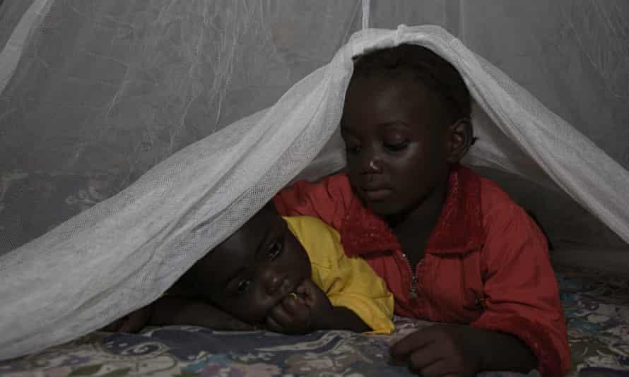 children and mosquito net