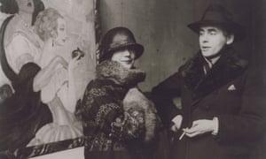 Gerda and Einar Wegener in front of Gerda's painting Sur la route d'Anacapri at an exhibition in 1924