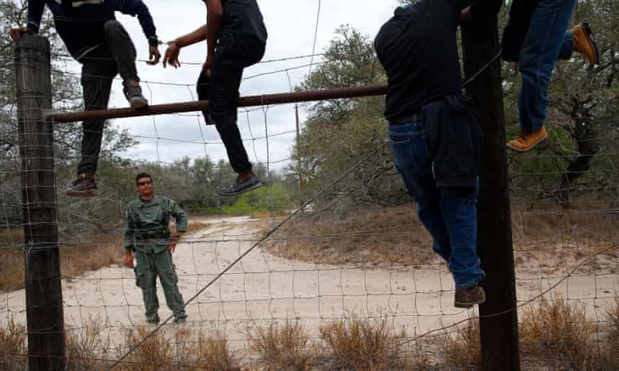 People are taken into custody by the US Border Patrol near Falfurrias, in Texas.