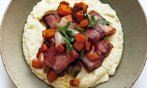 Cuts of carrot and pancetta with parsley on a mound of celeriac mash