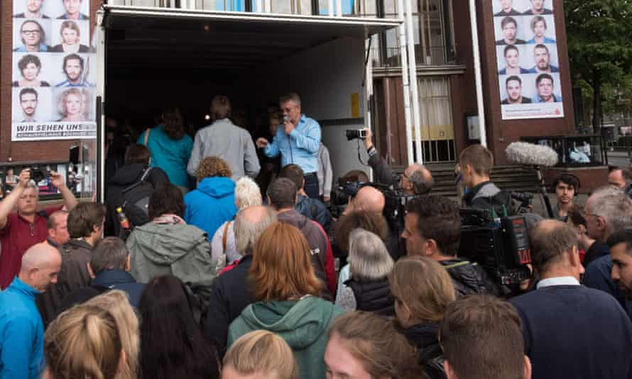 People try to pack into a lorry in Bochum, Germany, like the 71 who were found dead in Austria.