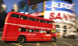 An original London Routemaster bus negotiates Piccadilly Circus in 2005.