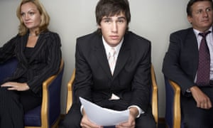 Job candidate dressed in suit holding CV