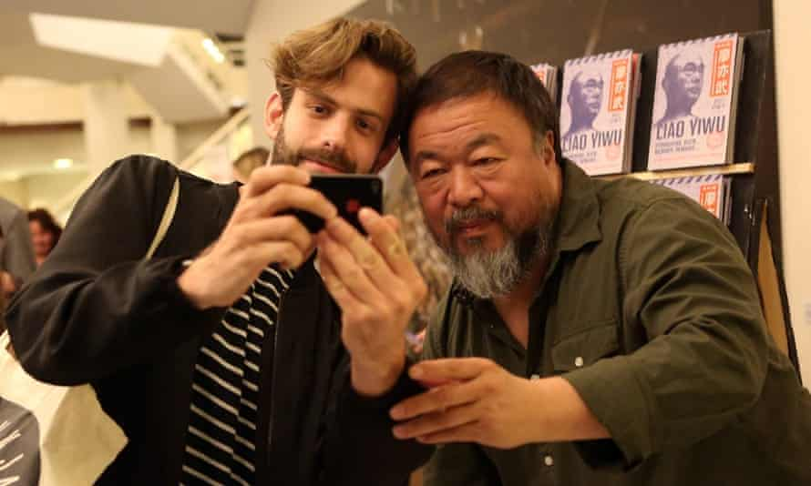 Ai Weiwei poses for a selfie after his panel discussion at the Berlin international literature festival on 2 September.