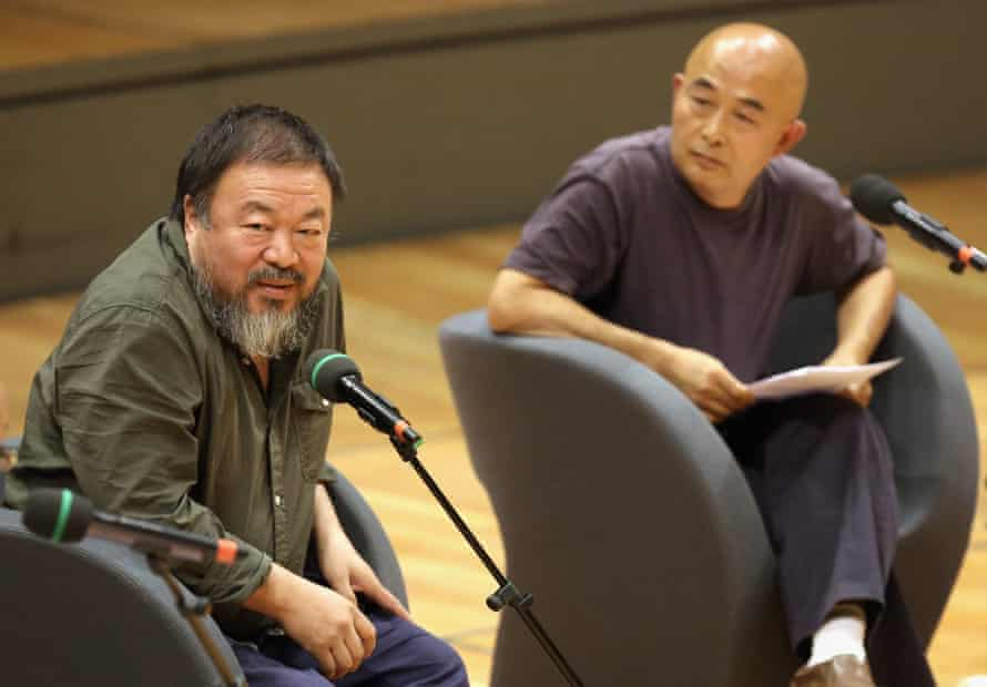 Ai Weiwei, left, and Chinese poet Liao Yiwu in discussion at the Berlin international literature festival.