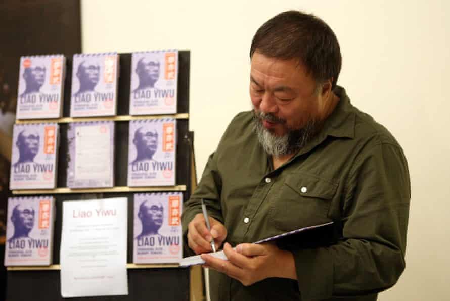 Ai Weiwei signs books in Berlin.