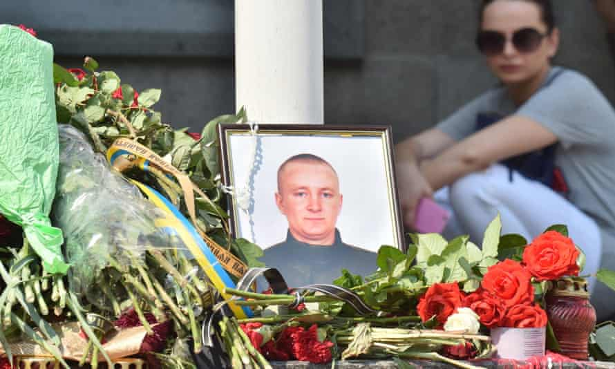 A portrait at the site where a police officer died during clashes in front of the parliament in Kiev on 31 August 31.