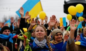 Pro-Ukrainian supporters raise their hands to remember the victims of violence in recent protests in Kiev in March, 2014.