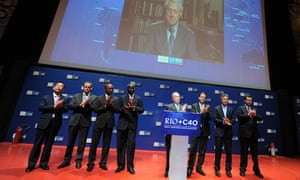 Babatunde Fashola (third from left) shares a stage with Michael Bloomberg of New York and others during the Rio+C40 Mega City Mayors Taking Action on Climate Change event in 2012.