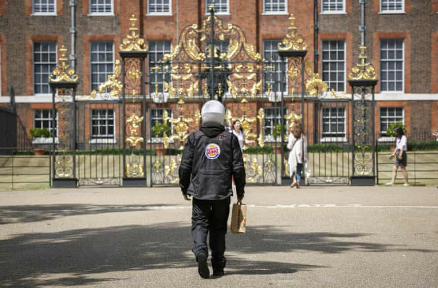 A delivery driver approaches Kensington Palace with a burger meal intended for resident Prince William.