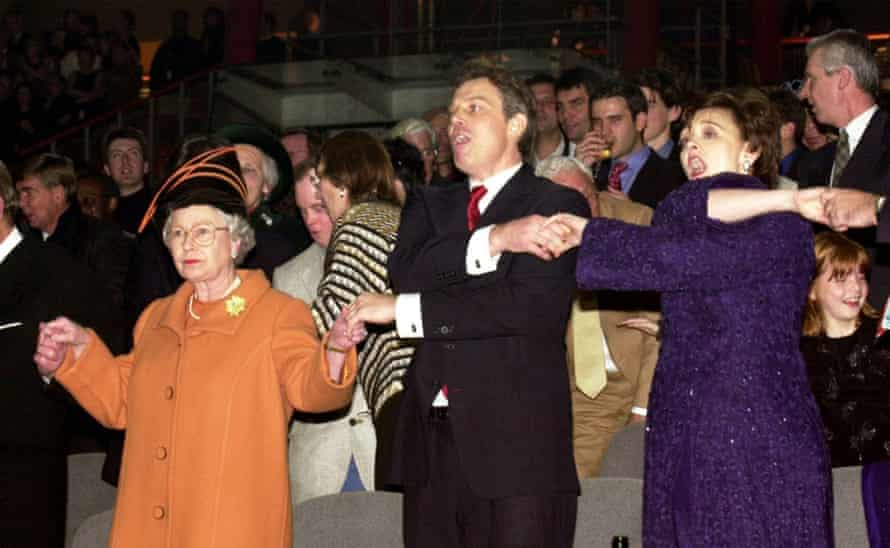 The Queen joins then prime minister Tony Blair and wife Cherie, singing Auld Lang Syne, during midnight celebrations to see in the millennium.