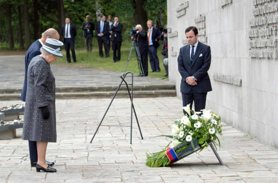 Queen Elizabeth II and the Duke of Edinburgh pay their respects to victims at the Bergen-Belsen concentration camp in Germany.