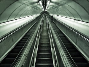 View of an empty escalator, taken from below, at Bank underground station, London.