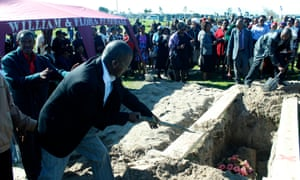 Mourners attend a funeral in Gugulethu.