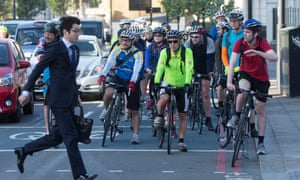 Cyclists on some existing, non-segregated bike infrastructure in London.